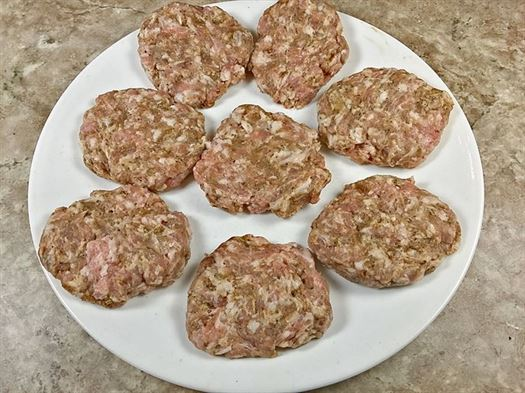 formed sausage patties on plate