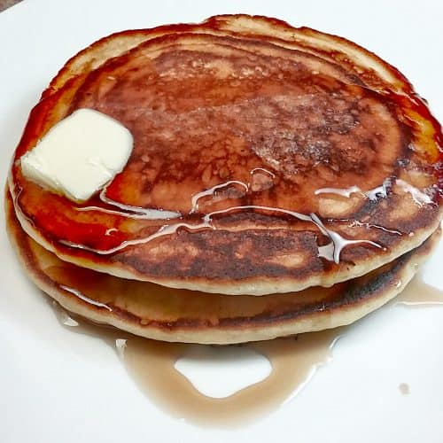 Low sodium buttermilk pancake with butter syrup sliding off