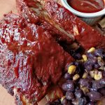 Pork ribs with beans and sauce